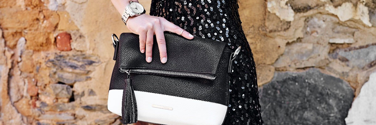 woman wearing a watch and carrying a handbag